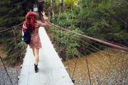 KEGAN MARLING - Groundswell visitor Ross Fur Trap parading across the footbridge.