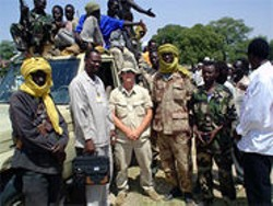 U.S. Marine Brian Steidle (center) photographed genocidal violence in Darfur.