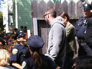 "Vendor ""Luke"" (in glasses) surrounded by police officers Saturday."
