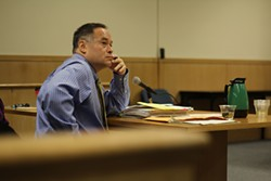 MATT SMITH - Veteran detective Frank Lee at a hearing on charges he resisted orders to search a journalist's home.