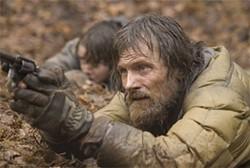 MACALL POLAY - Viggo Mortensen, as the Man, must cross a bleak, postapocalyptic landscape.