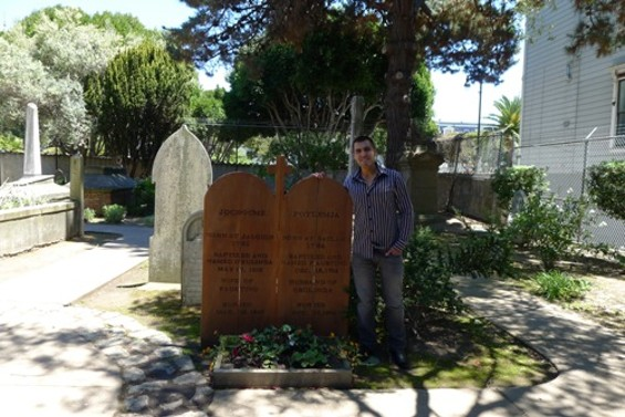 Vincent Medina stands next to the graves of his great-great-great-great-great-great grandparents, who also worked at Mission Dolores.