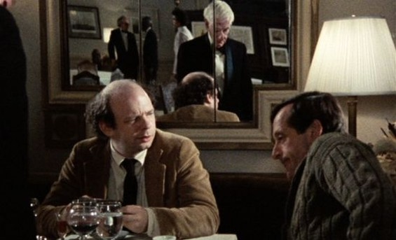 Wally (left) and Andre with their waiter reflected in the mirror behind them