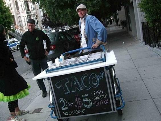 Weird Fish proprietor Timothy Holt and his new taco bike. - TAMARA PALMER