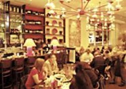ANTHONY  PIDGEON - Welcome Home: The chandeliers made of - teacups are typical at the witty Sydney's - Home.