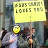 """Who Is That """"JESUS CHRIST LOVES YOU"""" Guy?"""