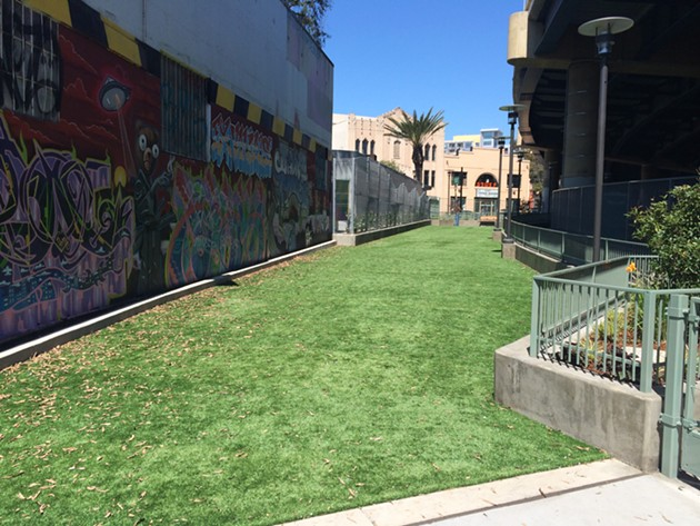 While oddly shaped, the new dog play area on Valencia should be a welcome oasis in a neighborhood starved for green space. - PETE KANE