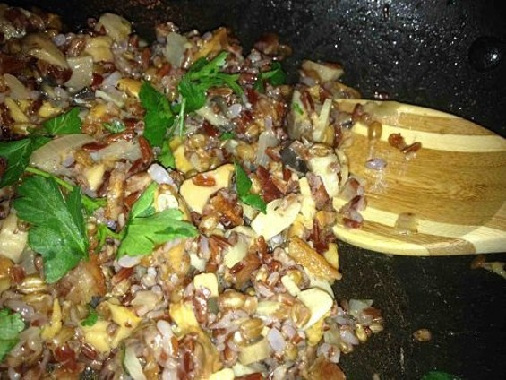 Wild mushroom ragout with bacon and Village Harvest's farro and red rice blend. - TAMARA PALMER