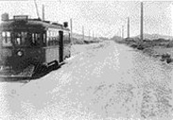 EMILIANO  ECHEVERRIA - With sand dunes in the background, the L - Taraval chugs down barren Taraval Street - in the 1920s.