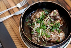 KIMBERLY SANDIE - Wo Hing General Store's steamed catfish with black bean sauce.