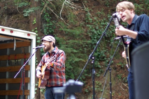 Woods, with Jeremy Earl at left.