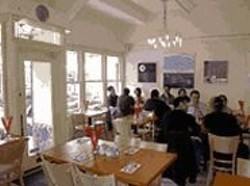 ANTHONY  PIDGEON - World Tour Cut Short: A bright, pale dining room - serves as home base for more than a dozen cuisines.