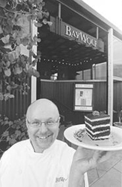 ANTHONY  PIDGEON - Yum: Bay Wolf pastry chef Earl Darny proffers a dessert.