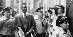 PHOTO COURTESY OF NY DAILY NEWS VIA GETTY IMAGES - Yusef Salaam is escorted into court in The Central Park Five.