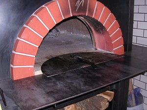Zero Zero's custom-built oven burns almond wood. - JOHN BIRDSALL