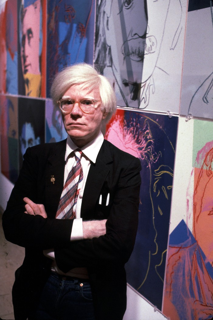 Warhol with his paintings, December 1980.