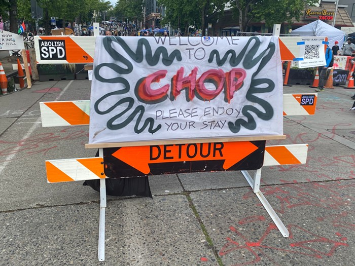 Signs around CHOP declare its new name, which stands for Capitol Hill Organized Protest, although some disagree with the new name.