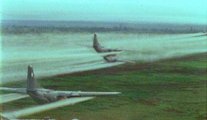 """A C-123 """"Provider"""" aircraft spraying Agent Orange over Vietnam during Operation Ranch Hand, 1962-1971."""