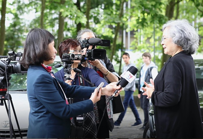 Tran To Nga addresses the press outside the Tribunal de Grande Instance courthouse in Evry, France.