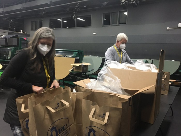 Volunteers examine the supplies at the Evergreen Clinic.