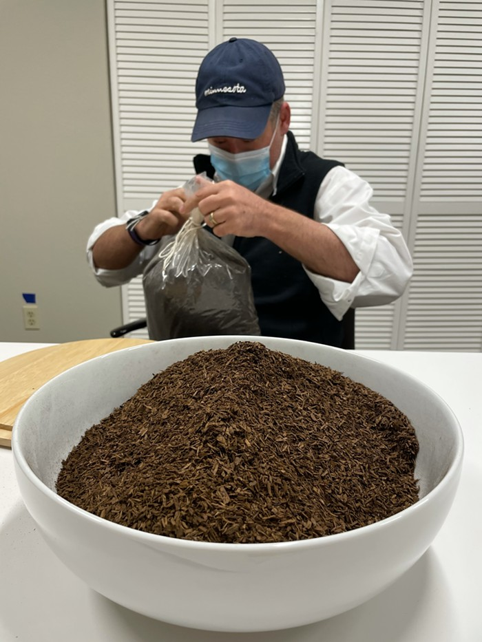 Return Home CEO Micah Truman opening up a bag of terramated compost.