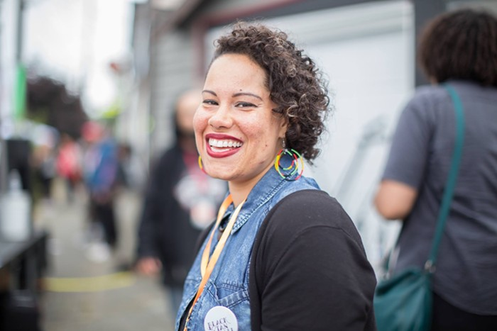 Nikkita Oliver (they/them) believes a city investment in peoples basic needs—not police—will create a truly safe community.