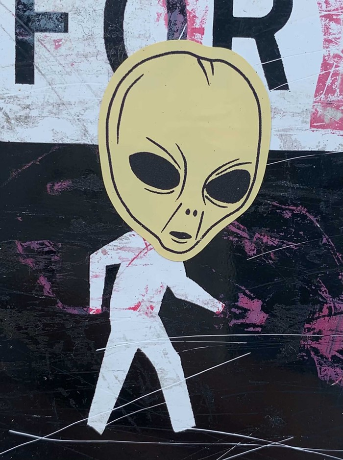 These alien heads have been popping up in a lot of places around Capitol Hill recently.