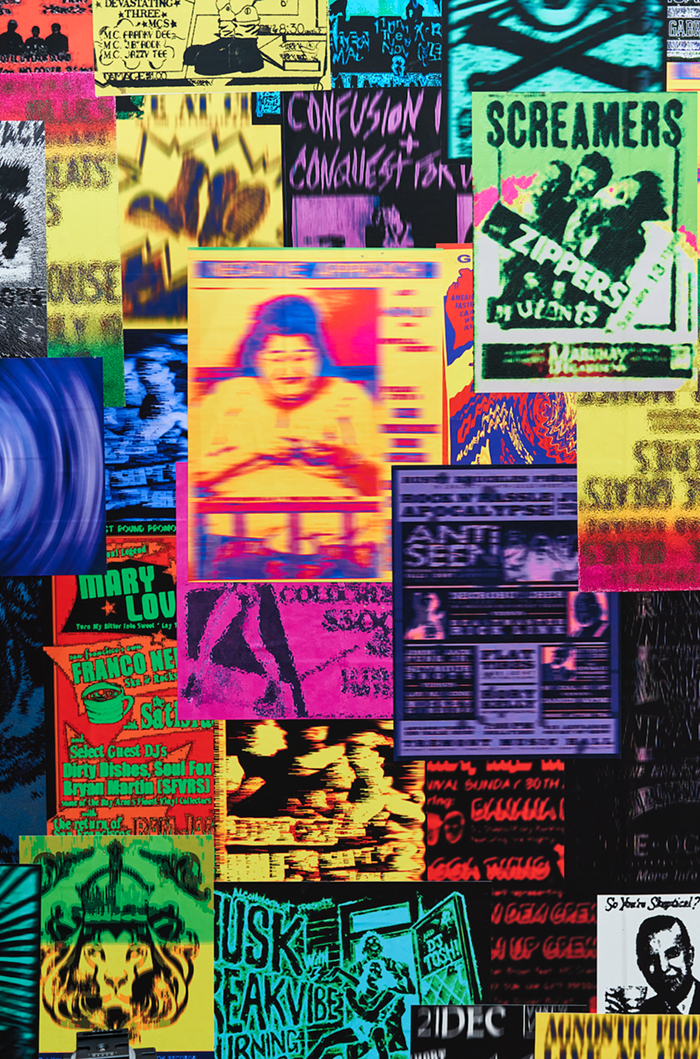 A close up of some of the posters plastered inside Garage Band.