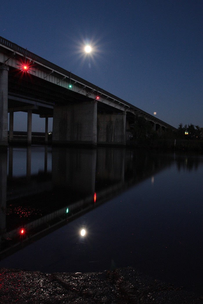 Yes, that is a full moon over the Ebey Slough Interstate 5 bridge in Marysville, Washington.