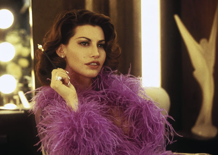Gina Gershon in Showgirls (1995), wondering if theres a place for midnight movies anymore.