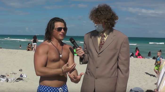 Andrew Callaghan talks to spring breakers in Miami for his first video on his new YouTube channel, Channel 5.