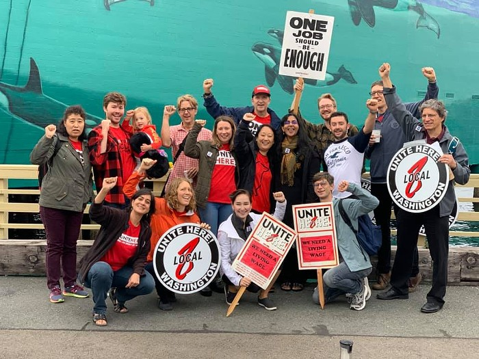 Seattle City Councilmember Kshama Sawant stands with members of UNITE HERE Local 8 at the Edgewater Hotel picket in 2019.