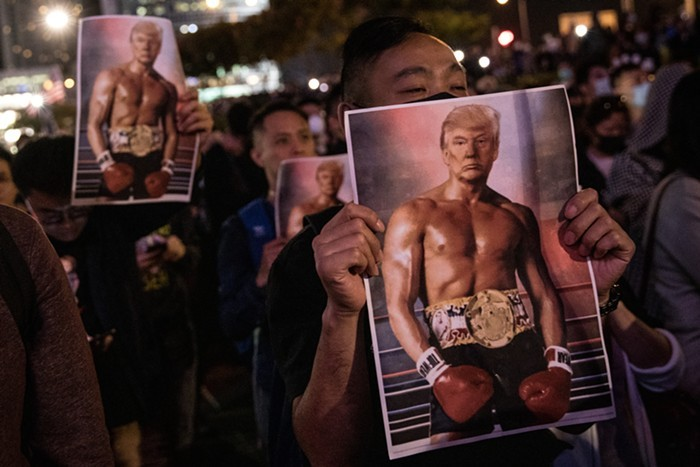 Hong Kong protesters holding up pictures of swole Trump during last years pro-Democracy demonstrations.