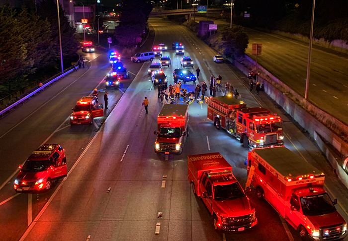 First responders on I-5 at approximately 1:45 am on July 4, 2020, after a driver plowed into two Black Femme March protesters, killing one and seriously injuring another.