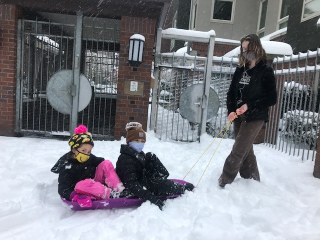 I dont know why Seattle residents own sleds but these kids are fortunate that they do.