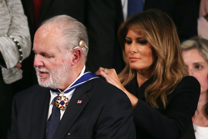 The news broke this morning, but the death of Rush Limbaugh, seen here receiving the Asshole Who Ruined America award, dominated todays news cycle.
