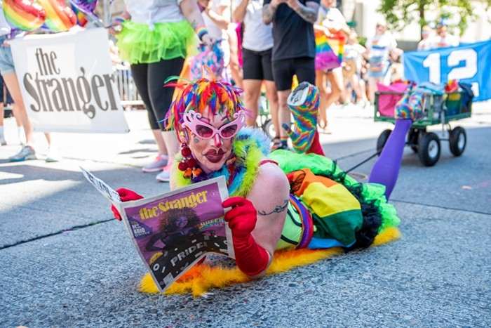 Miss Texas 1988 pretends to be able to read during the 2019 Pride parade.