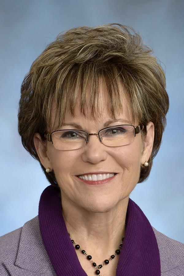 Kathy Lambert needs a permanent vacation from public office.