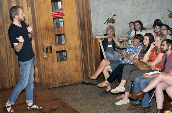 A crowd at Balliceaux listens to a storyteller during the popular bimonthly event, Secretly Y'all, Tell Me a Story — where organizers ask that the stories be true.