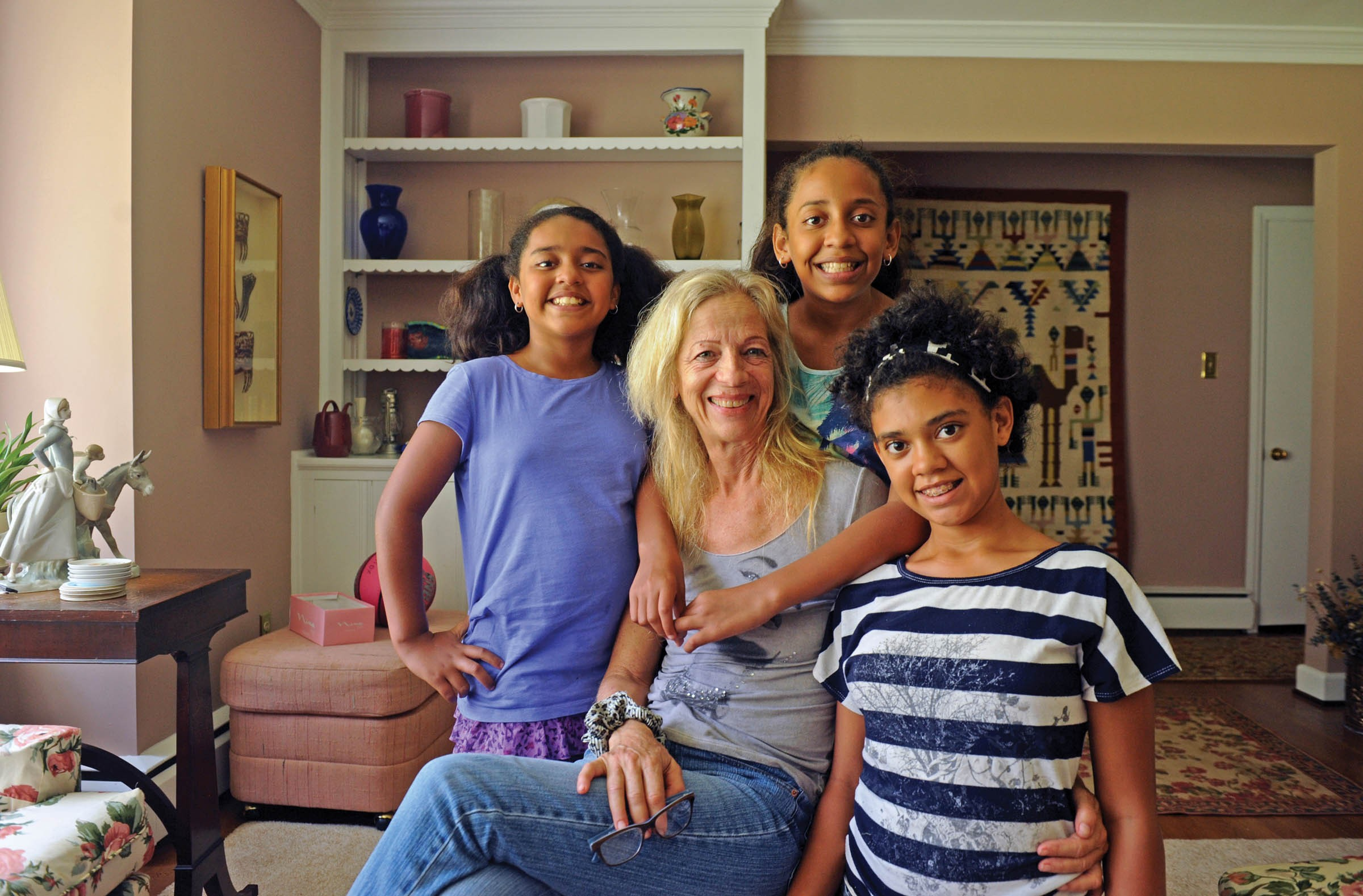 A decade after Ceil Gruessing spotted the three sisters Angie, Jazmin and Roxana, from left, in a cardboard box in Honduras, the new family has moved to Henrico County where the girls start school this week. - SCOTT ELMQUIST