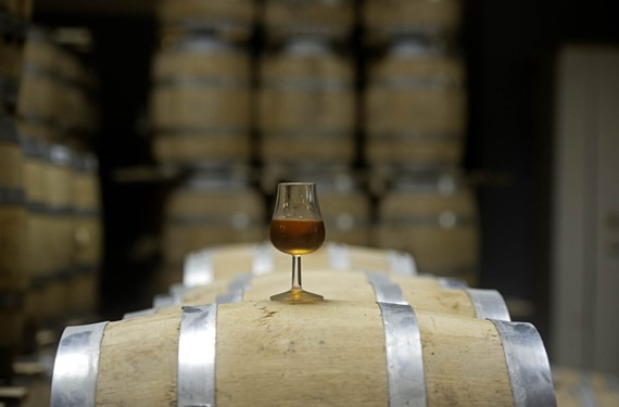 A glass of Reservoir Distillery's wheat whiskey spends more than two years in a charred white oak barrel before it can be bottled.