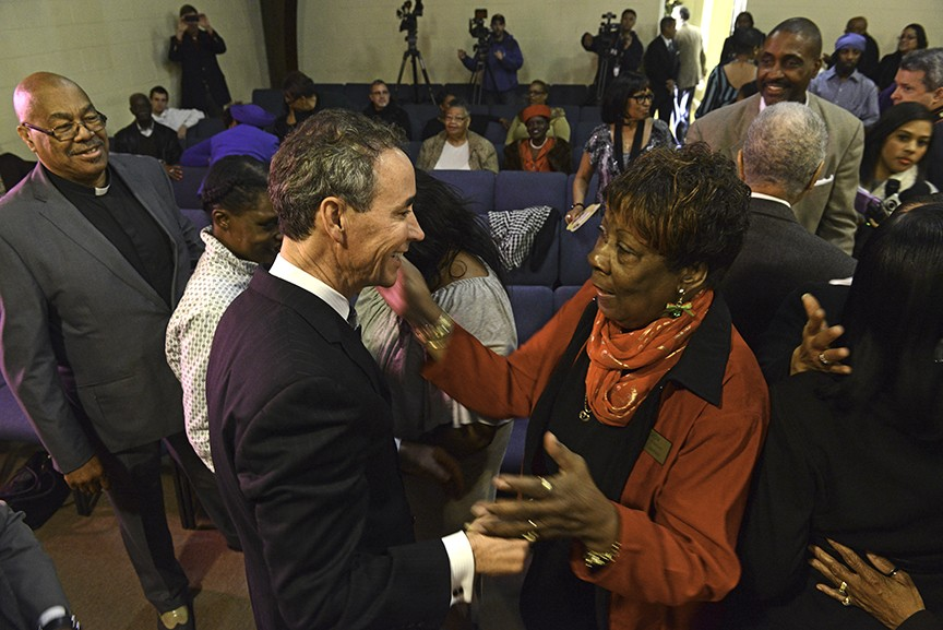 A member of New Kingdom Christian Ministries embraces embattled Delegate Joe Morrissey during a church service Sunday. - SCOTT ELMQUIST