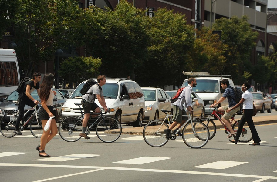 A pack of cyclists rides down West Broad Street near Virginia Commonwealth University, which has won a designation as a bicycle-friendly school in spite of the city's bike-challenged infrastructure. - SCOTT ELMQUIST
