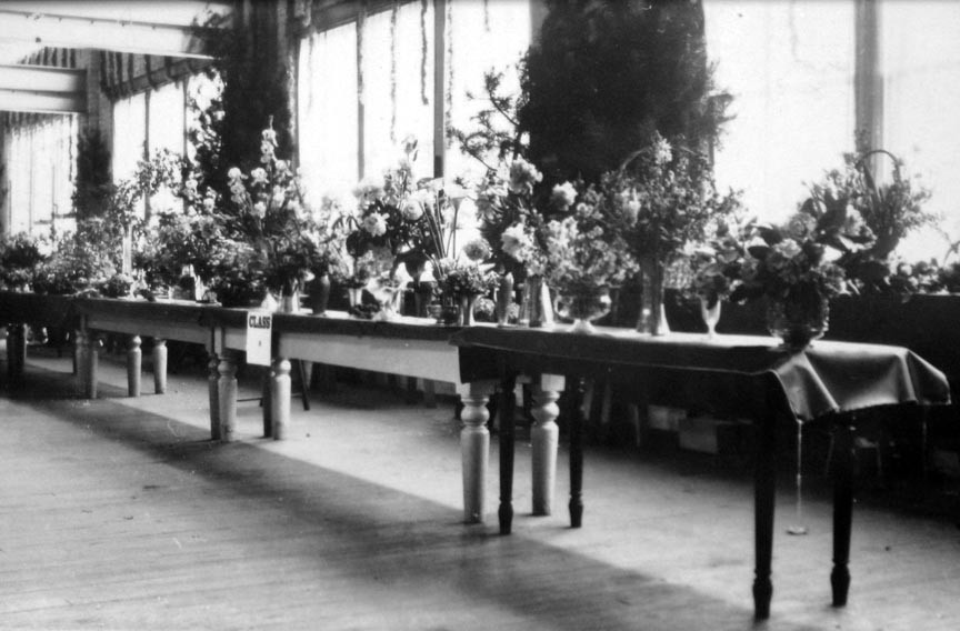 A rare interior view of the old Coliseum, now the Coliseum Lofts, located at 1367 W. Broad St. Harris Stilson and his wife, Mary, both enjoyed gardening and she may have had an entry in the flower competition shown in this undated photograph. - COPYRIGHT RICHMOND IN SIGHT
