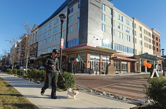 A resident walks his dog near the Aloft Hotel. - SCOTT ELMQUIST