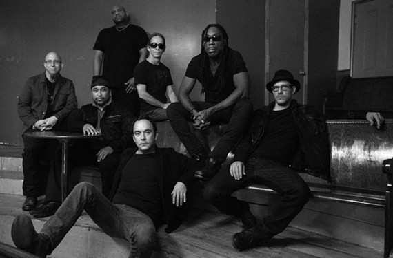 A Richmond financial manager has been accused of wire fraud from Boyd Tinsley, shown at top right in a photograph of the Dave Matthews Band.
