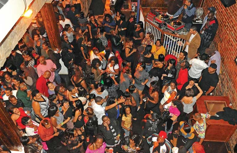 A Saturday night crowd parties at Vision Ultra Lounge in Shockoe Bottom. - SCOTT ELMQUIST