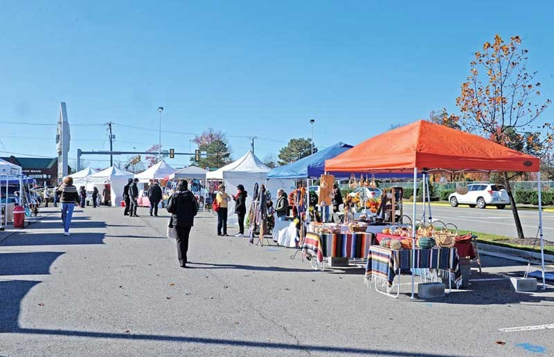 A small farmers' market in the Chesterfield Towne Center parking lot, which opened this spring, plans to move inside the mall on Black Friday. - SCOTT ELMQUIST