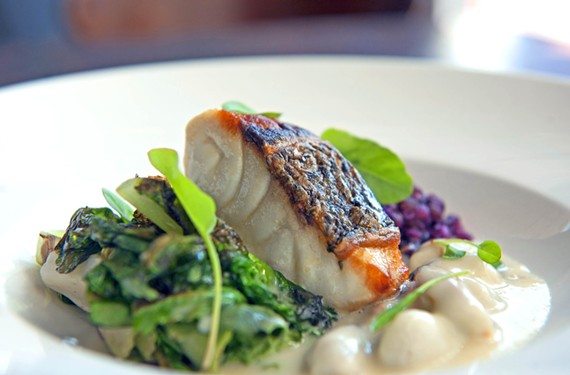 A spring entree standout at Dutch & Co., Style Weekly's Restaurant of the Year, is smoked rockfish with mixed grains and seeds, grilled cabbage purée, charred greens and mussel broth.