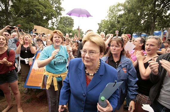 A week after Teresa Sullivan was forced to resign as president of the University of Virginia, students and faculty rally behind her June 18. - JAY PAUL
